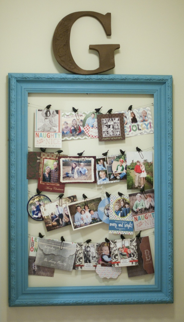 Picture frame memo board re-vamp using wire stands and clothespins or paperclips.  Perfect for Christmas cards!