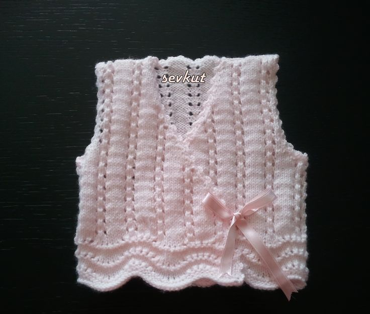 http://www.ravelry.com/projects/sevkut/baby-girl-vest-3