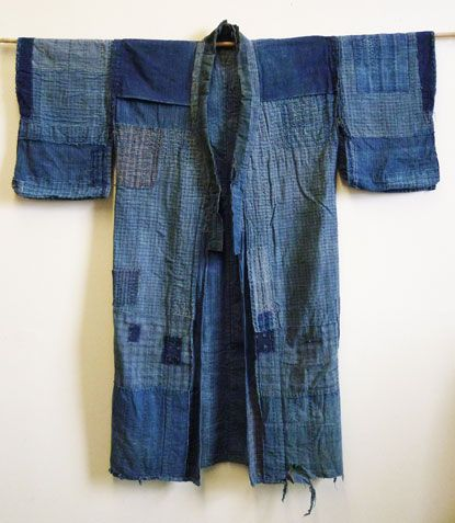 """late 19th century boro work coat on Sri Threads. """"It is hand stitched from old  home spun, hand woven cottons of great variety.  There's wonderful sashiko stitching–and the indigo blue is beautifully faded and worn.  But for me it's the ito aji or thread flavor that makes me admire this piece so much."""""""