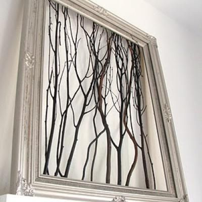 glue branches inside empty picture frame for unique and textural artwork