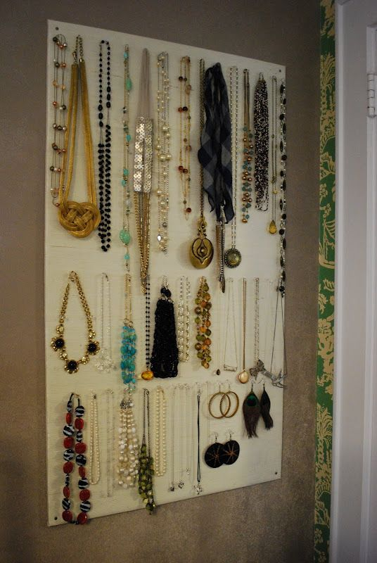 DIY Jewelry Display - I plan on using canvas and eye hooks/door pulls instead of homasote and push pins