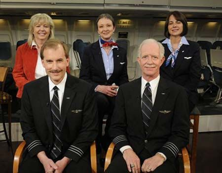 """The crew of US Airways Flight 1549: Doreen Welsh, Donna Dent, Sheila Dail,  co-pilot Jeffrey Skiles, and Captain Chesley """"Sully"""" Sullenberger,III. On January 15, 2009, Capt. Sullenberger  and his crew safely guided Flight 1549 to an emergency water landing in New York City's frigid Hudson River. Captain and crew received international acclaim for their actions that day, including the passage of a Congressional resolution recognizing their bravery."""