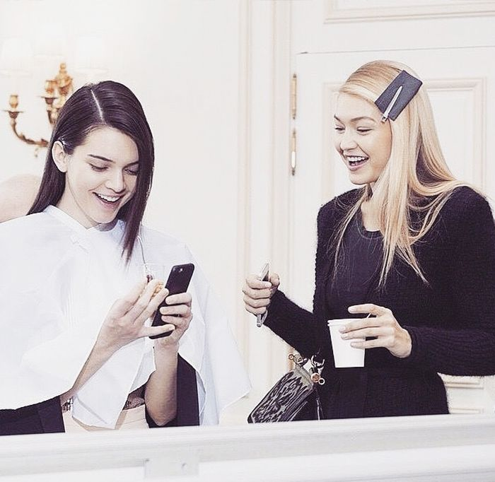 Kendall Jenner and Gigi Hadid share a laugh backstage in casual pieces