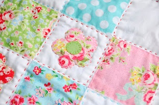 appliques and hand quilting pretty patchwork quilt