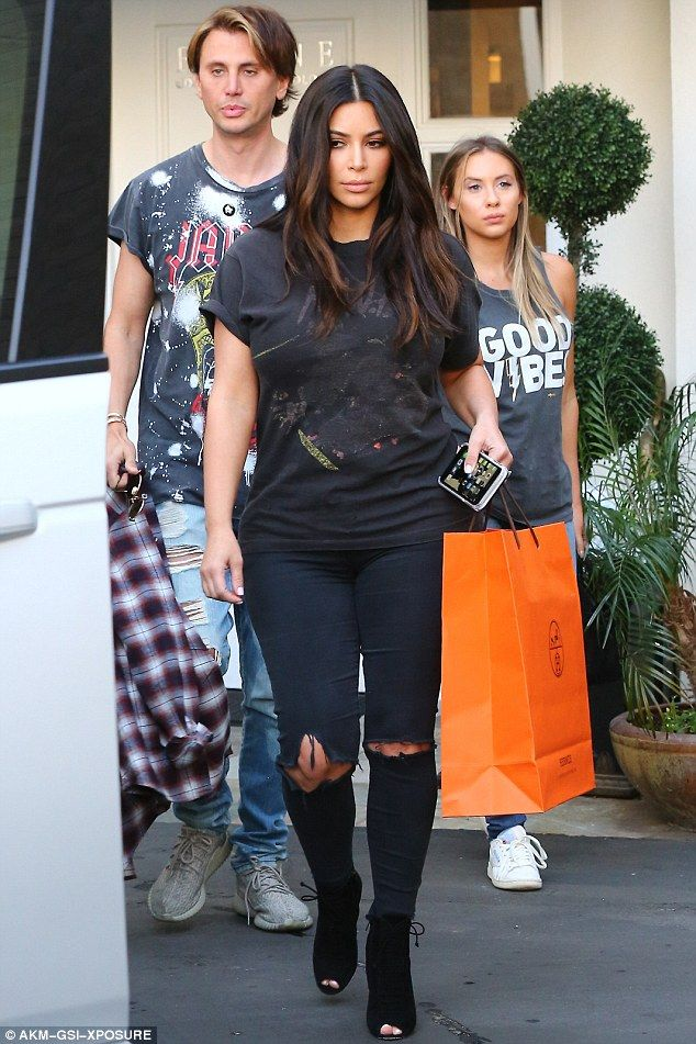 Changing it up:Kim Kardashian broke with her signature style on Thursday as she headed out in Beverly Hills, California, withJonathan Cheban and his girlfriendAnat Popovsky