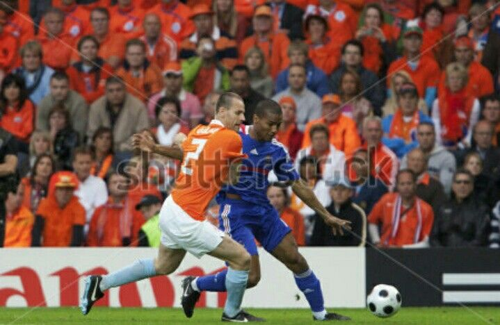 Holland 4 France 1 in 2008 in Bern. Florent Malouda hss a battle getting past Andre Ooijer in Group C at Euro 2008.
