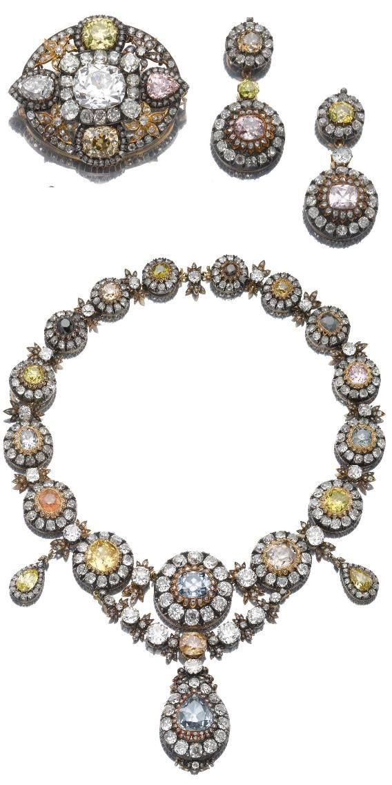 FORMERLY THE PROPERTY OF H.I.H. PRINCESS NESLISHAH ABDEL-MONEIM - A Magnificent and Unique Diamond Parure, Mid 19th. Century. Comprising: a necklace; with a pair of ear pendants and a brooch centring on a cushion-shaped near-colourless diamond and diamond clusters.