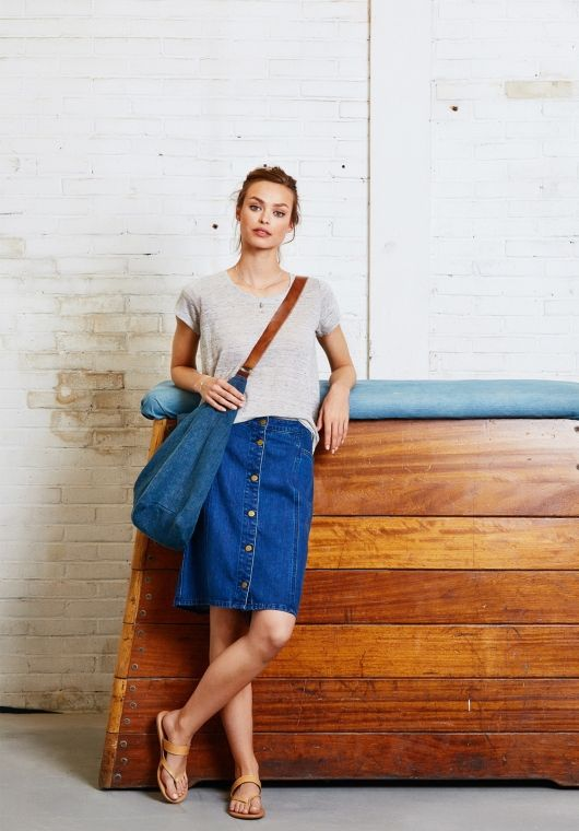 Add a 70s vibe to your wardrobe with this knee-length denim skirt; a cool classic, button through.