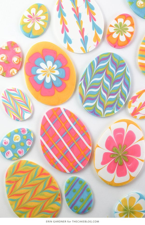 Marbled Chocolate Easter Eggs -how to make marbled Easter egg toppers for cakes and cupcakes using chocolate coating and cookie cutters | by Erin Gardner for TheCakeBlog.com