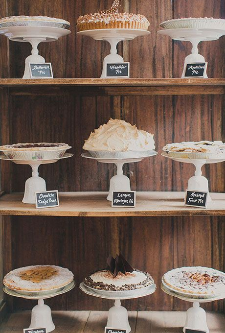 Brides.com: . A tiered display of assorted wedding pies.