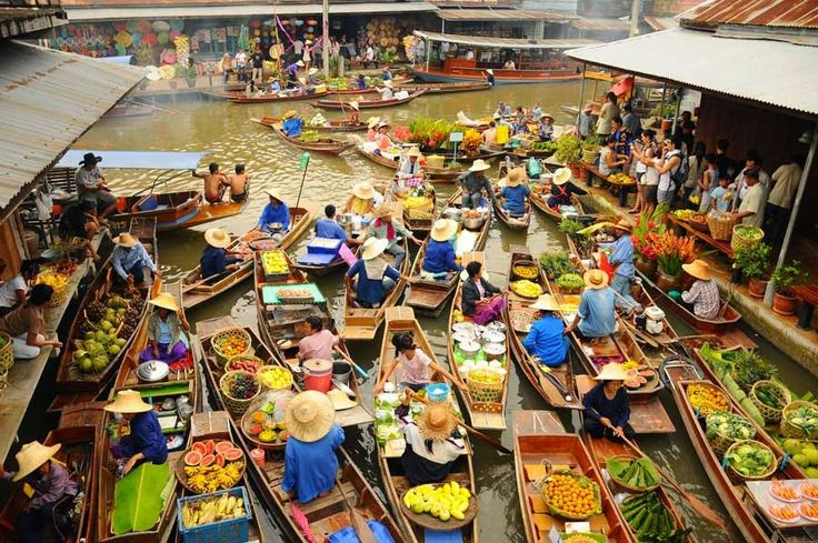 Floating Market – Damnoen Saduak Crowded more with tourists than local these days, the boats in the floating markets are piled with tropical fruit and vegetables, fresh coconut juice and food cooked from floating chickens right on the boat.  read more @ http://www.worldatglance.com/2014/12/7-must-visit-places-of-bangkok.html