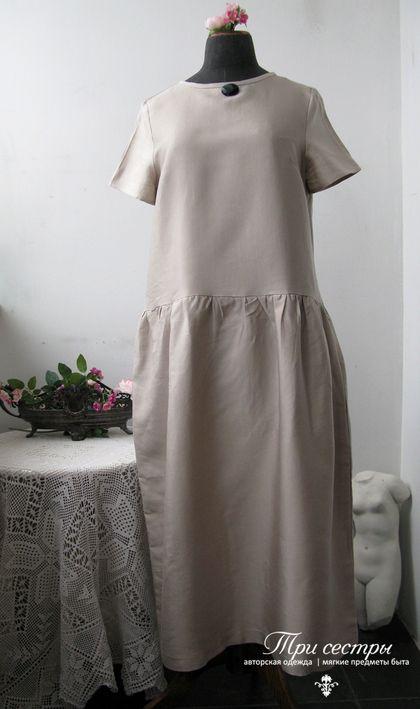 Свободное платье из тафты. Длина ниже колена, талия занижена.  К такому элегантному платью достаточно бросить нитку жемчуга или старинную брошь.