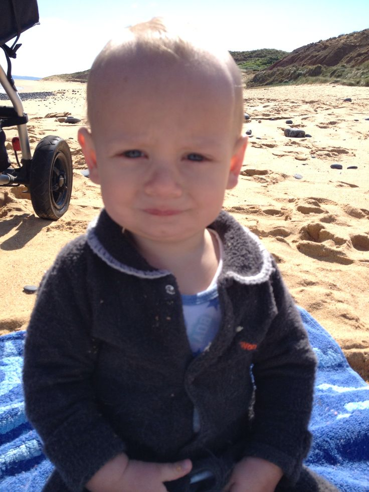 Not happy on the beach lil man Mitchy lol.