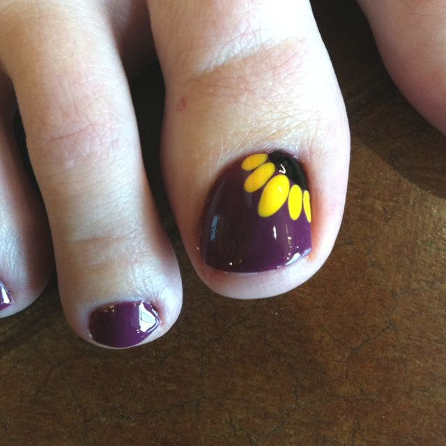 Sunflower toenail design                                                                                                                                                                                 More