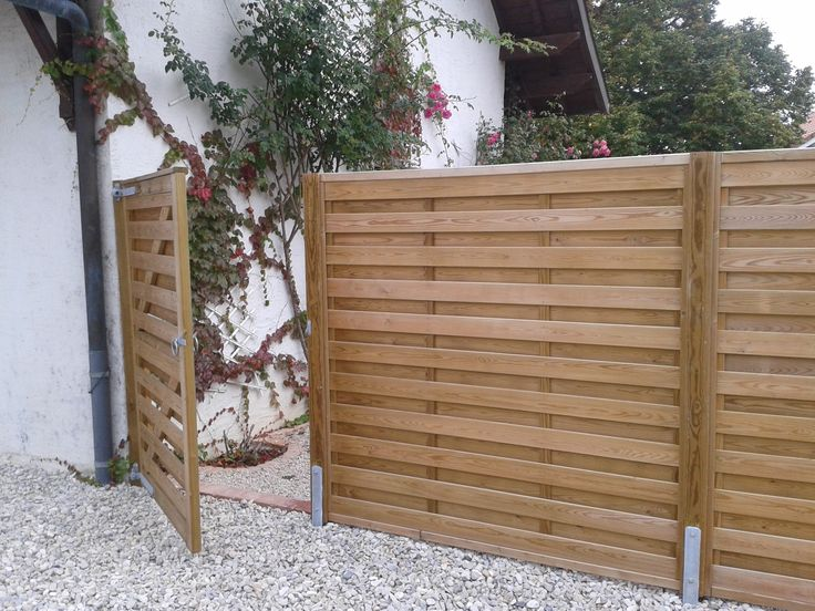 Jacksons horizontal 'Hit and Miss' fence panels with matching gate | #garden…