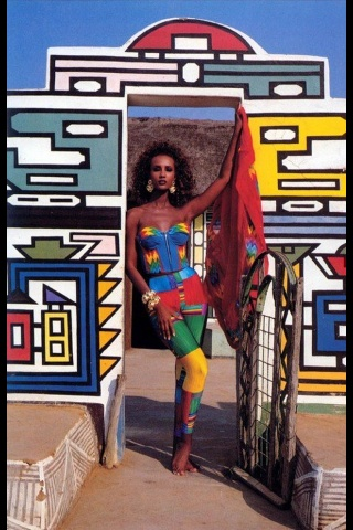 Ndebele is noted as the beginning of African Art here Iman poses in front on a house with Ndebele.
