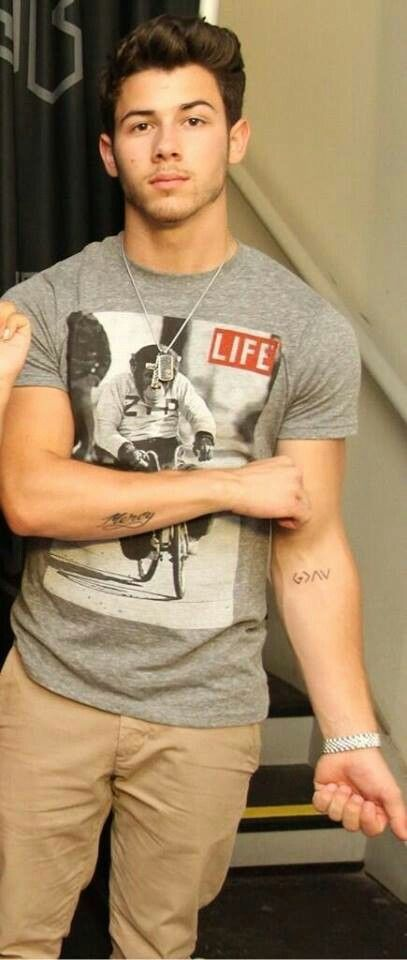 "Nick Jonas'  new tattoo. ""God is greater than the ups and downs"""