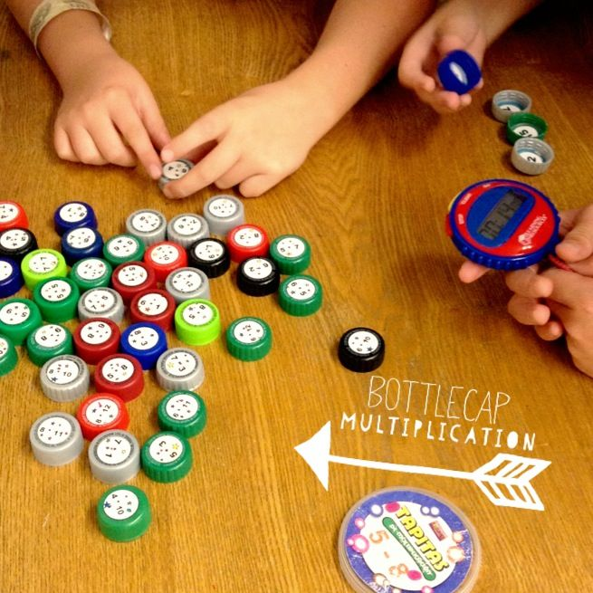 Bottle Cap Multiplication - One student sees how many facts he can answer in one minute, one student times, and one student checks the answers inside the caps. A favorite for three years now with my kiddos! http://flapjackeducationalresources.blogspot.com/2011/11/math-facts-bottle-cap-recycling.html