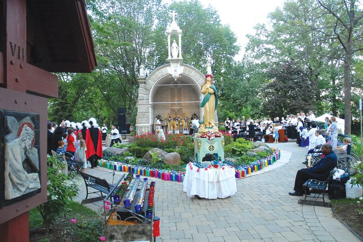 Faithful gather for Mass at the grotto of Assumption Grotto Parish for the Feast of the Assumption on Aug. 15, 2012. The grotto, as it stands today, was dedicated in 1881 and renovated and rededicated in 2002.