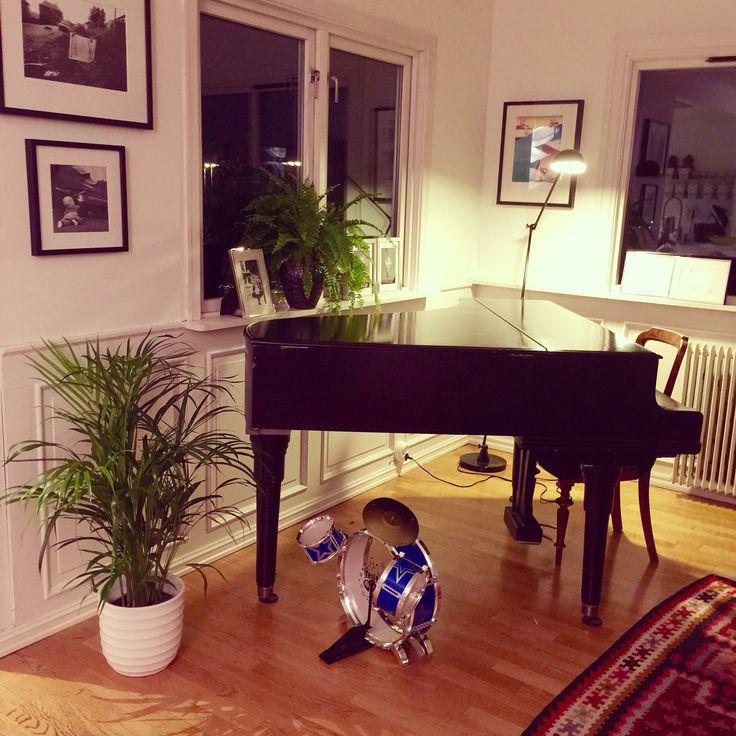 Our grand piano. IKEA 20 year old Kelim rug.