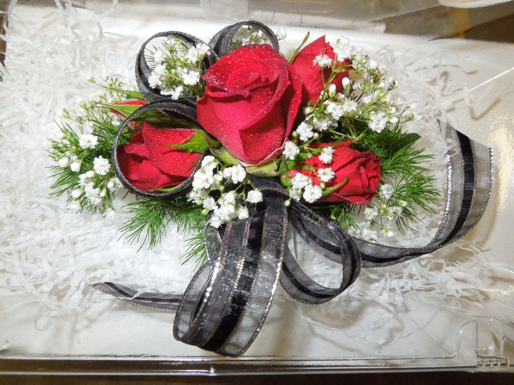 A black, white and red corsage for prom or homecoming. Designed by Your Flower Shop at Stauffers of Kissel Hill. www.skh.com.