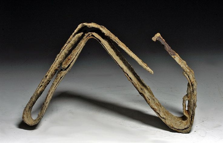Celtic ritualistically killed iron sword, Central Europe, 2nd-1st century B.C. Iron sword that was ritualistically bent into a ribbon of steel, originally 92 cm long. Private collection