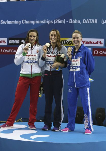 Katinka Hosszu of Hungary, Mireya Belmonte Garcia of Spain and Hannah Miley of Great Britain celebrates on the podium after the Women's 400m Individual Medley during day one of the 12th FINA World Swimming Championships in Doha, Qatar.