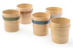 This craft is called Odate bentwood work. It is made of Japanese cedar cut into very thing slices. These nice cups are a very modern design variation of this very old craft from northern Japan.