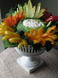 cabbage bowl for dip...Love this idea.  I use a clean, faux cement garden urn.