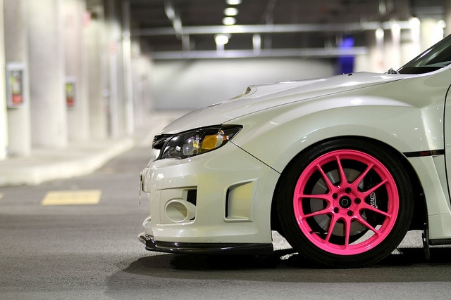 I also like the white car with pink rims...might consider it over the black with pink rims.
