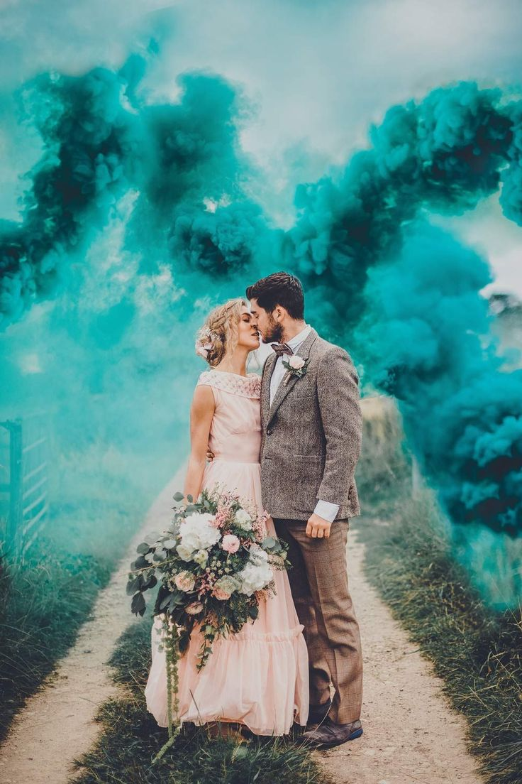 Picking the right wedding photographer is such an important decision – but with so many different options, it can be difficult to judge how much a wedding photographer should cost. Both this guide to wedding photography prices and our list of questions to ask you photographer can help to take the confusion out the process. This inspiring wedding photo with smoke bombs is by Poppy Carter Portraits. #weddingportrait