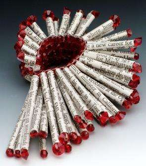 Holly Anne Mitchell's Newspaper Jewellery, 2005.  See too Kathleen Dustin's recent neckpiece.