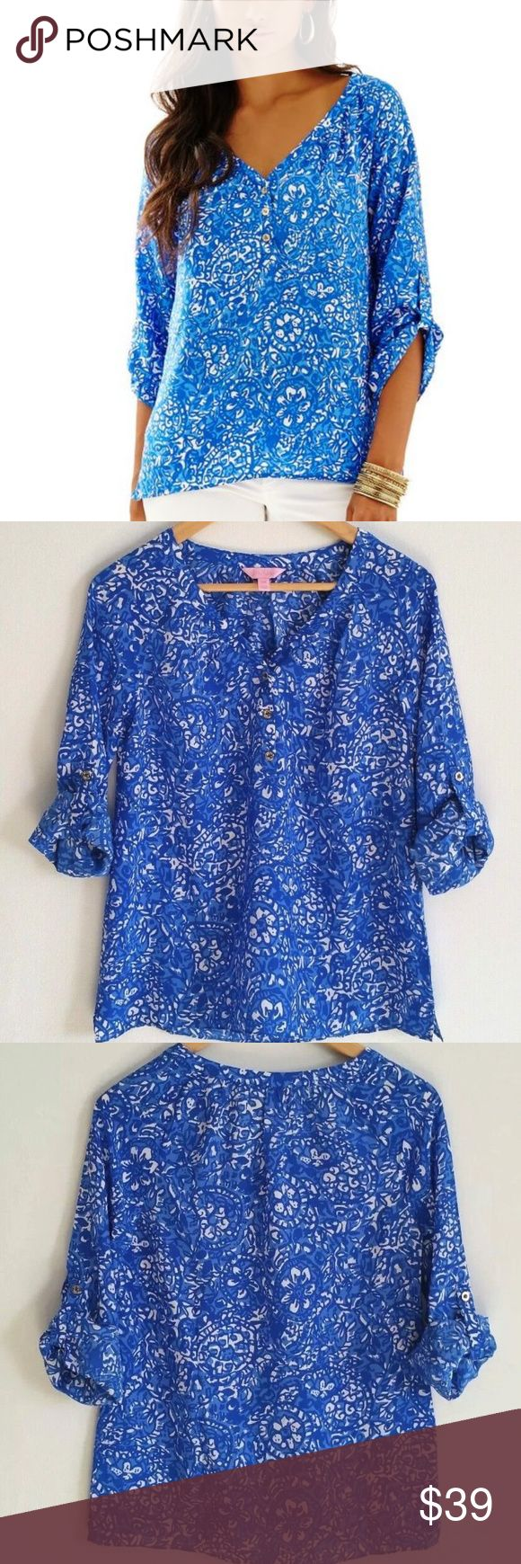 """Lilly Pulitzer Silk Tye Top Give Em Shell Shirt Lilly Pulitzer Women's Silk Tye Top Blue Give Em Shell Tab Sleeves  Women's Size:  XXS ( See Measurements, generous fit )  The Tye Top is a magnificent printed silk long sleeve shirt that you won't be able to get enough of. Gold Buttons at Front  V-Neckline Top With Sleeve Tab Detail.  (100% Silk). Dry Clean Only. Imported.  Measures Approx 25"""" Length From Shoulder to Front Hem  Measures Approx 17-17.5"""" Underarm to Underarm  Smoke & Pet Free…"""