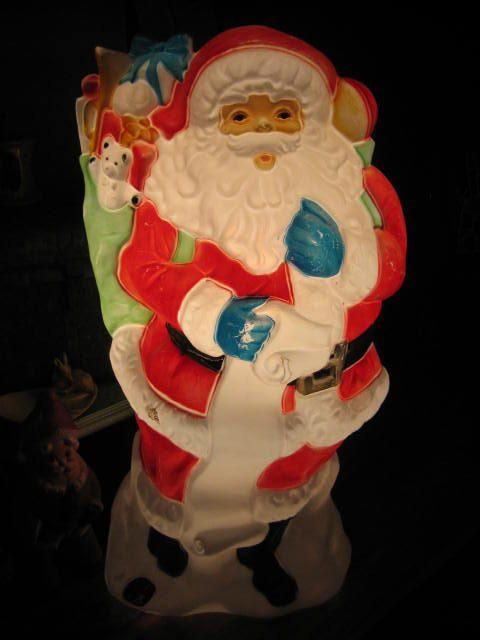 """Vintage Christmas Blow Mold ~ Santa Claus Holding His List w/ an Overflowing Bag of Toys & Presents. 42"""" tall."""