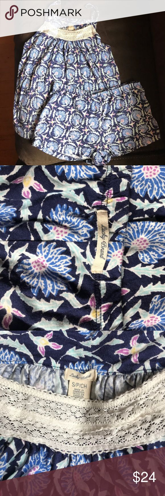 Lucky Brand Pajama Short Set Print is like an exotic floral in shades of blue. Pink, and cream. Lace detail on front neckline. Only worn a couple of times. Lucky Brand Intimates & Sleepwear Pajamas