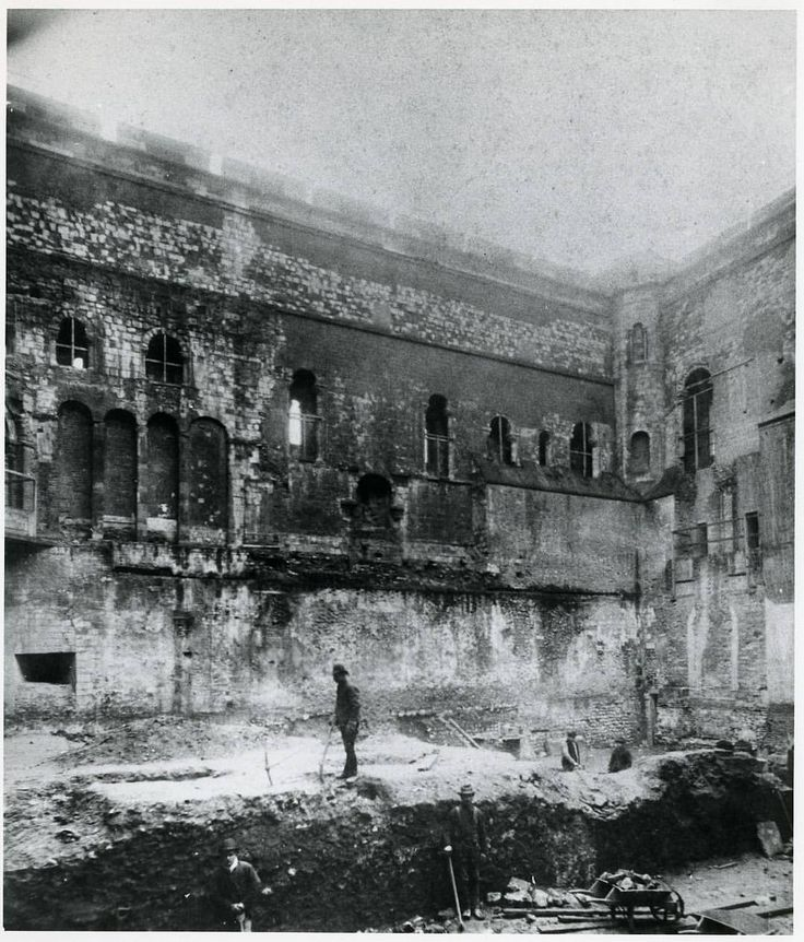 """Norwich Castle Keep """"This photo from the late 1880s or early 1890s shows excavations in the Castle Keep before its conversion to a museum. The dark arch with 'ears' in the middle of the wall was once the King's fireplace, and was one of the first castle hearths to be built into the wall rather than placed in the centre of the room."""""""