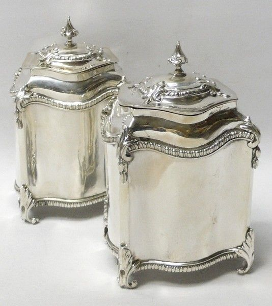 Pair of Antique George III Silver Tea Caddies // An elegant pair of antique sterling silver tea boxes of plain serpentine form having gadroon borders and cast leaf scroll feet and ornaments. With domed pull off lids. Weight 661 grams, 21.2 troy ounces.  London 1770. Maker Samuel Wood (known for his sugar casters).  Country of originEngland Started working1733 Stopped workingCirca 1775 -   PriceGBP 3,350.00  //  - Maria Elena Garcia -  ► www.pinterest.com/megardel/ ◀︎