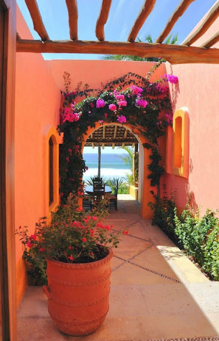 Modern Adobe House Exterior Design - I love the flowers and the open roof