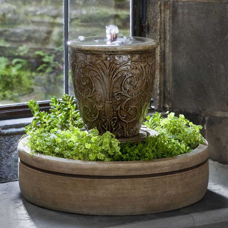 tuscan decor - I would love this in my lower flower bed