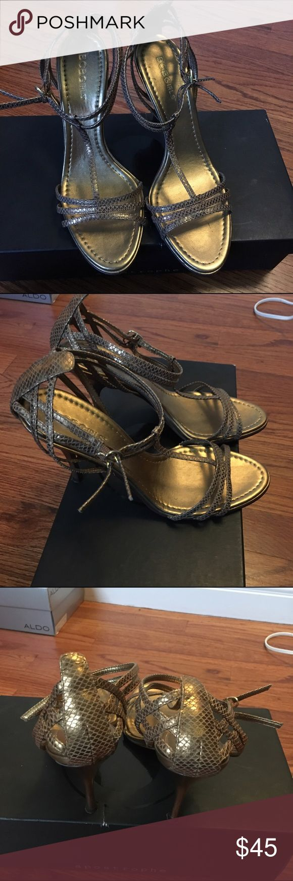 Brown/gold sandal heels Snake skin type look. T-strap with double buckles for closure. BCBGirls Shoes Heels