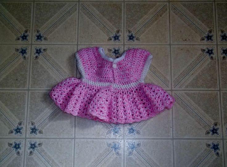 crocheted little girls dress. aprox 6 to 9 months. extra ruffles at the waist