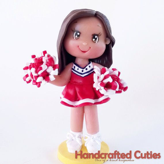 This cute chibi girl in chearleading outfit is one of a kind, handmade, and 100% made out of polymer clay and is finished with matte glaze for