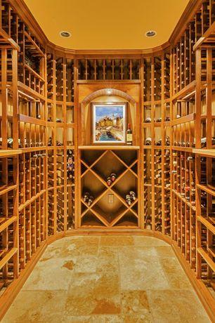 Mediterranean Wine Cellar with Traditional Series 192-Bottle Rectangular Bin Wine Rack, Crown molding, limestone floors