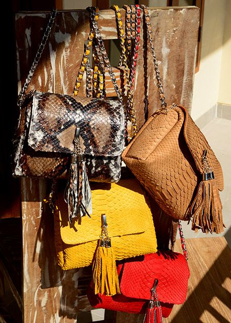 http://www.ebay.com/itm/GENUINE-PYTHON-LEATHER-YELLOW-NEW-BAG-WITH-TASSELS-SNAKE-SKIN-CLUTCH-8-6-3-/271774844122?pt=LH_DefaultDomain_0&hash=item3f470b04da