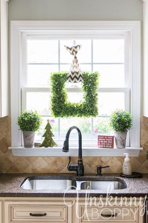Kitchen window Christmas decor- square boxwood wreath with boxwood topiaries