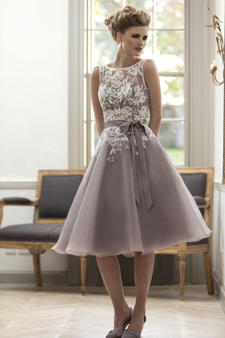 True Bridesmaid - M570 Organza T-length bridesmaid dress with boat neckline, pretty lace laid over a fitted bodice and circular 'fifties' style skirt. Zip up back with button trim. To view this dress please call 01273 736622 or visit http://www.oceanbride.co.uk/appointments. Our Bridesmaids dresses are available in over 90 beautiful colours!