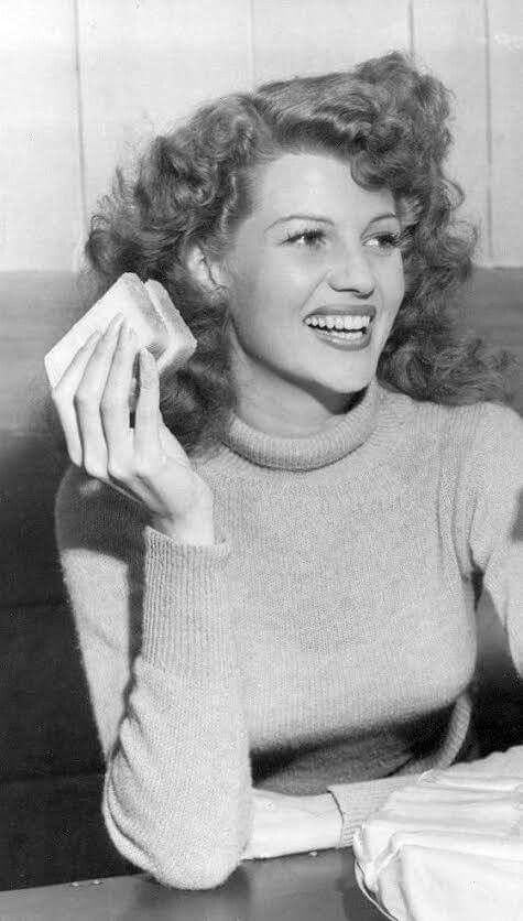 Rita Hayworth at the Hollywood Canteen, 1944 mid 40s hairstyles curly movie star casual day looks vintage fashion style sweater