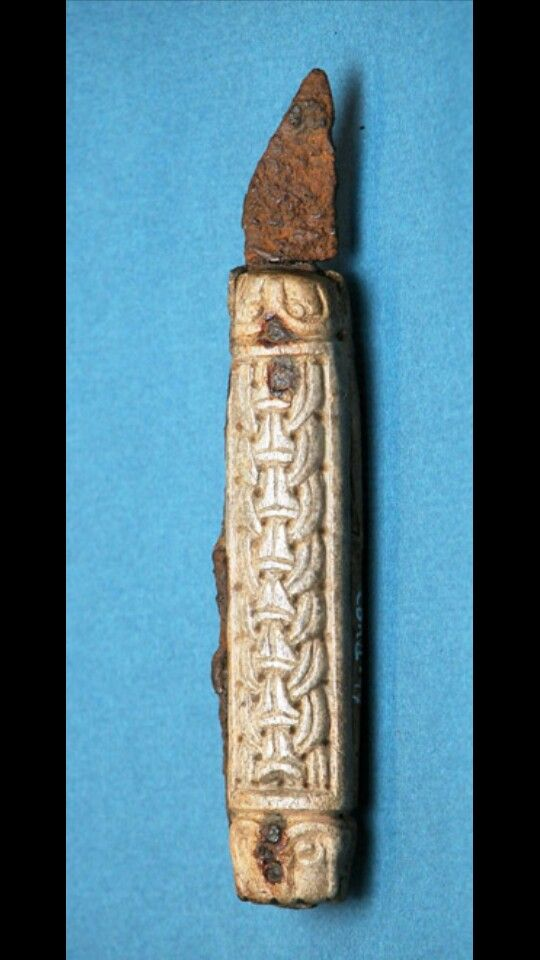 A double bladed folding knife found in Canterbury. The knife is a rare type found usually in saxon sites, but uniquely is decorated with the viking Børre style ringwork.