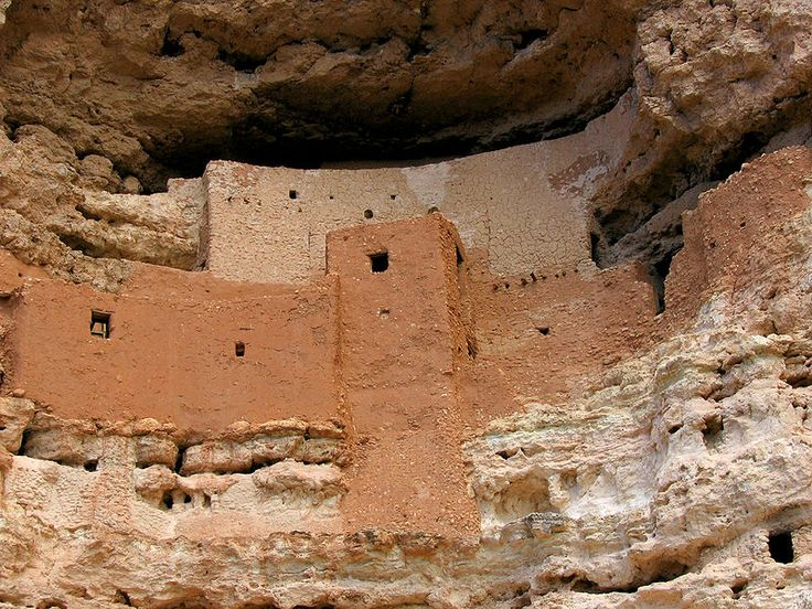 Montezuma Castle National Monument protects a set of well-preserved cliff dwellings near the town of Camp Verde, Arizona, United States. The dwellings were built and used by the Sinagua people, a pre-Columbian culture closely related to the Hohokam and other indigenous peoples of the southwestern United States, between approximately 1100 and 1425 AD. The main structure comprises five stories and twenty rooms, and was built over the course of three centuries.