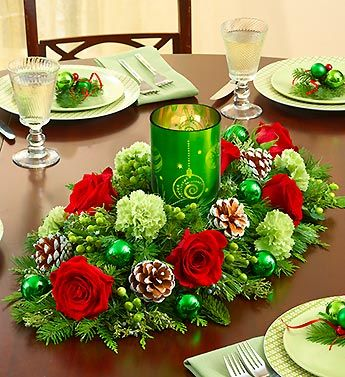 Red flowers and greens for Christmas complete with a Christmas candle in the middle, make the perfect Christmas centerpiece! Starting at $49.99.